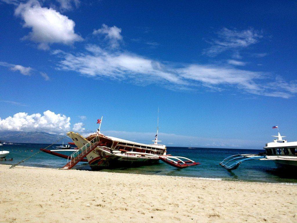 Ferries waiting to row at White Beach, Puerto Galera, Philippines