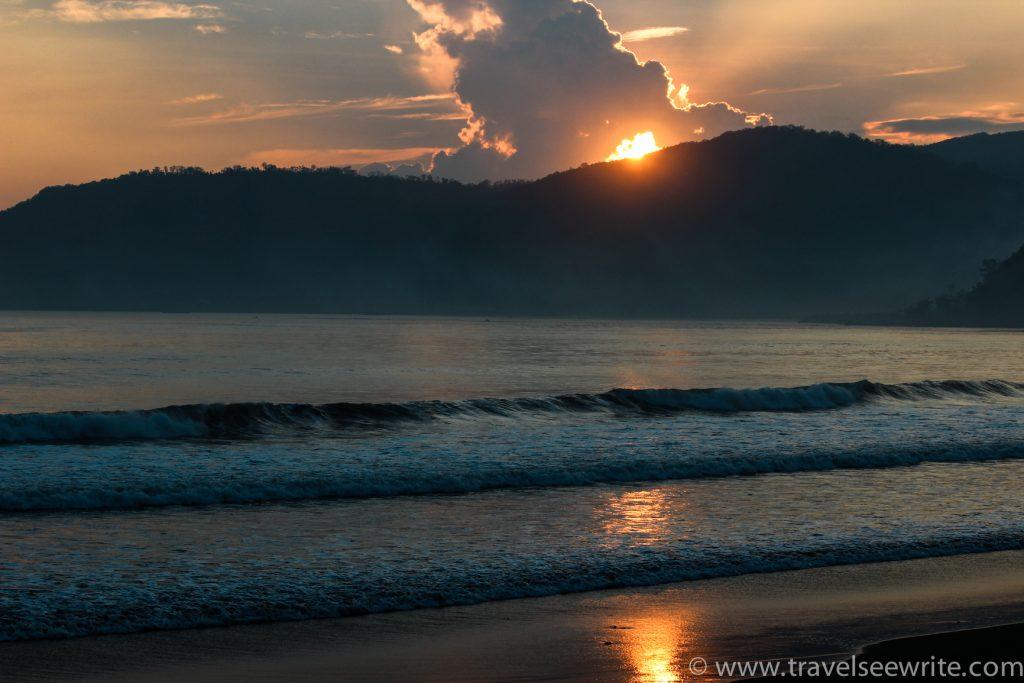 Sun playing hide and seek, Sabang Beach, Baler